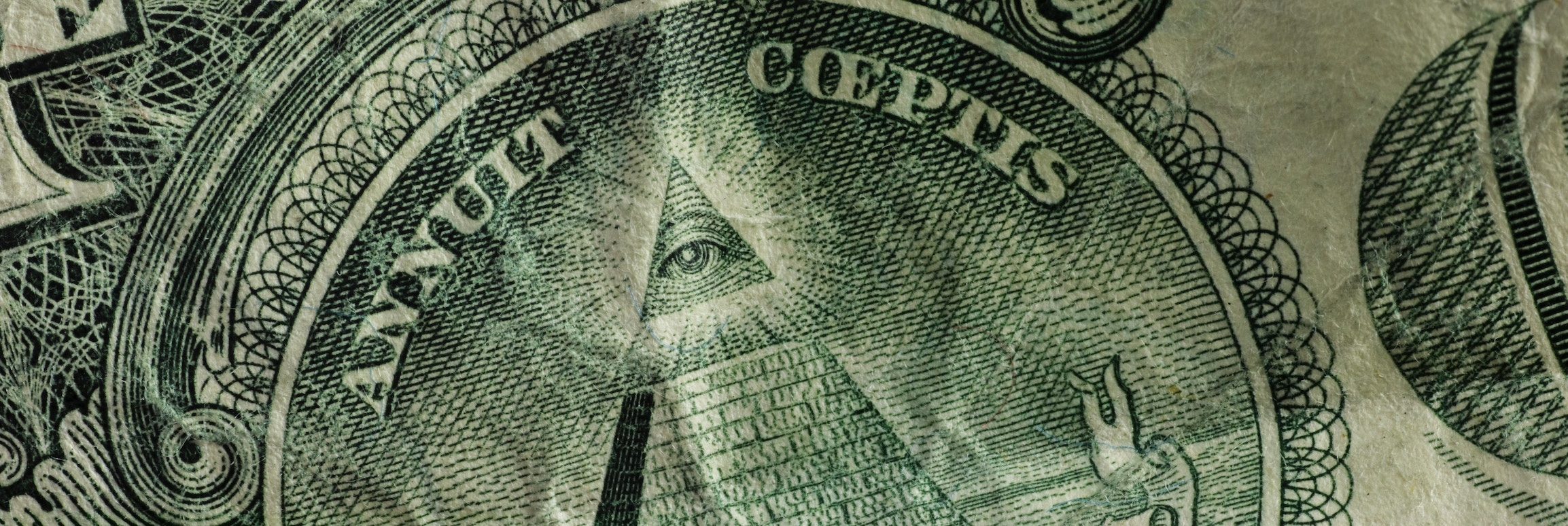 Dollar bill, all seeing eye zoomed in.